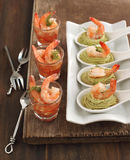 Tomato salsa with shrimp and Avocado cream and shrimp in spoon Royalty Free Stock Photos