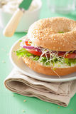Tomato sandwich on bagel with cream cheese onion lettuce alfalfa Royalty Free Stock Image