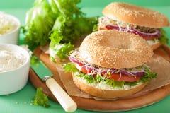 Tomato sandwich on bagel with cream cheese onion lettuce alfalfa Royalty Free Stock Photo