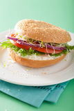 Tomato sandwich on bagel with cream cheese onion lettuce alfalfa Royalty Free Stock Photography