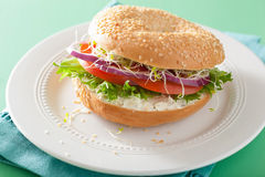 Tomato sandwich on bagel with cream cheese onion lettuce alfalfa Stock Image