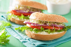 Tomato sandwich on bagel with cream cheese onion lettuce alfalfa Stock Images