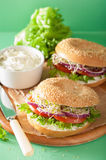 Tomato sandwich on bagel with cream cheese onion lettuce alfalfa Stock Photo