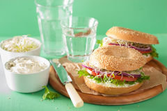 Tomato sandwich on bagel with cream cheese onion lettuce alfalfa Royalty Free Stock Images