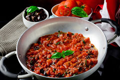 Tomato Sauce with basil and olives Royalty Free Stock Photography