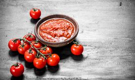 Tomato sauce in bowl. On black background royalty free stock images