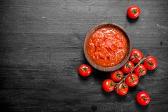 Tomato sauce in bowl. On black background stock photography