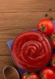 Tomato sauce in bowl on wood stock photos
