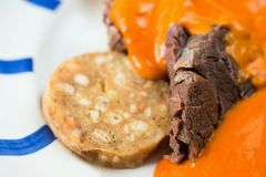 Tomato sauce, bread dumplings and beef. stock photography