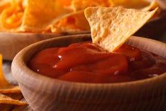 Tomato sauce and corn chips nachos macro. horizontal Royalty Free Stock Photography