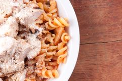 Tomato sauce with diced chicken and fresh whole wheat rotini Stock Photo