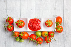 Tomato sauce and fresh tomato Stock Images