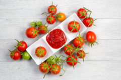 Tomato sauce and fresh tomato Royalty Free Stock Images