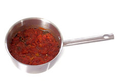 Tomato sauce. In front of white background Royalty Free Stock Photos
