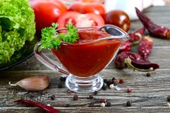 Tomato sauce with garlic, spices, herbs Stock Photography