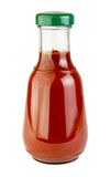 Tomato sauce in glass bottle Stock Images