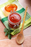 Tomato sauce in glass jar Stock Images