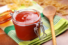 Tomato sauce in glass jar Stock Photography
