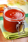 Tomato sauce in glass jar Stock Image