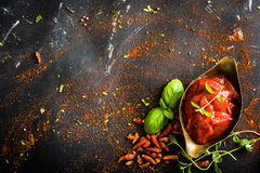 Tomato sauce in a gravy boat Stock Photo