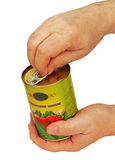 Of tomato sauce in hand. Closed metal can of tomato sauce in the man's hands Royalty Free Stock Photos