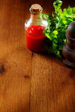 Tomato Sauce and Herbs on Table with Copy Space Stock Photo