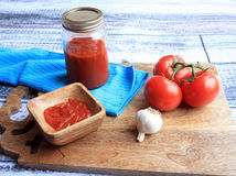 Tomato sauce ingredients and sauce  inside in jar side view Stock Images