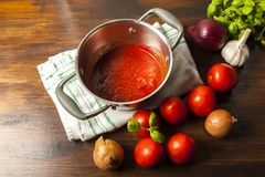 Tomato sauce is an inseparable ingredient of many dishes. Tomato sauce is an inseparable component of many dishes - the basis of Italian cuisine Stock Photos