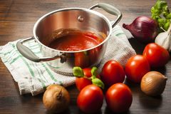 Tomato sauce is an inseparable ingredient of many dishes. Tomato sauce is an inseparable component of many dishes - the basis of Italian cuisine Royalty Free Stock Photo