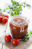 Tomato sauce (jam) in glass jar royalty free stock images