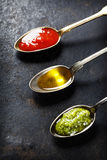 Tomato sauce, olive oil and pesto Royalty Free Stock Image