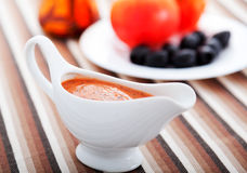Tomato sauce with olives Stock Images