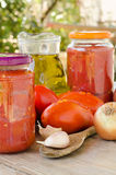 Tomato sauce and other ingredients Stock Images