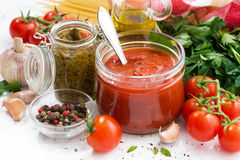 Tomato sauce, pesto and ingredients for pasta on a white table Royalty Free Stock Photo