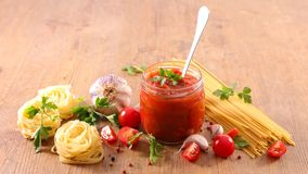 Tomato sauce. And raw pasta Royalty Free Stock Images