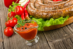 Tomato sauce with sausage Royalty Free Stock Photography