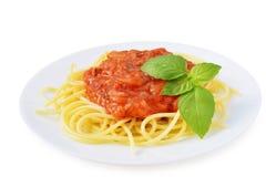 Tomato sauce with spaghetti on white Stock Photos