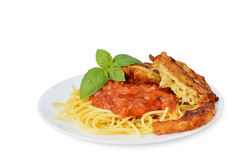 Tomato sauce with spaghetti and zucchini fritters on white background Stock Photos