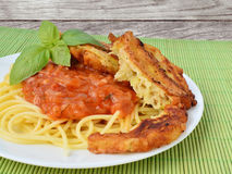 Tomato sauce with spaghetti and zucchini fritters Stock Photo
