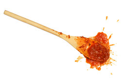Tomato sauce spoon. A wooden spoon dropped on the floor after stirring the tomato sauce royalty free stock photos