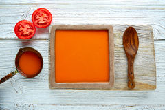Tomato sauce on square dish and white wood Stock Image