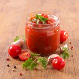 Tomato sauce. And ingredient on wood Royalty Free Stock Images