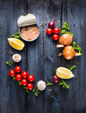 Tomato sauce with tuna fish ingredient with herb, spices and lemon on blue wooden background Royalty Free Stock Photography
