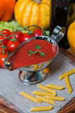 Tomato sauce in a white sauce boat with fresh ingredients Stock Photo