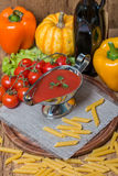 Tomato sauce in a white sauce boat with fresh ingredients Royalty Free Stock Photography