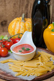 Tomato sauce in a white sauce boat with fresh ingredients Royalty Free Stock Photo