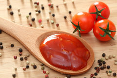 Tomato sauce in a wooden spoon Royalty Free Stock Photography