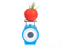 Tomato on scale Stock Photo