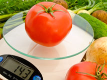Tomato on the scales Royalty Free Stock Images