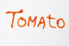 Tomato sign with ketchup on the white background Stock Photo